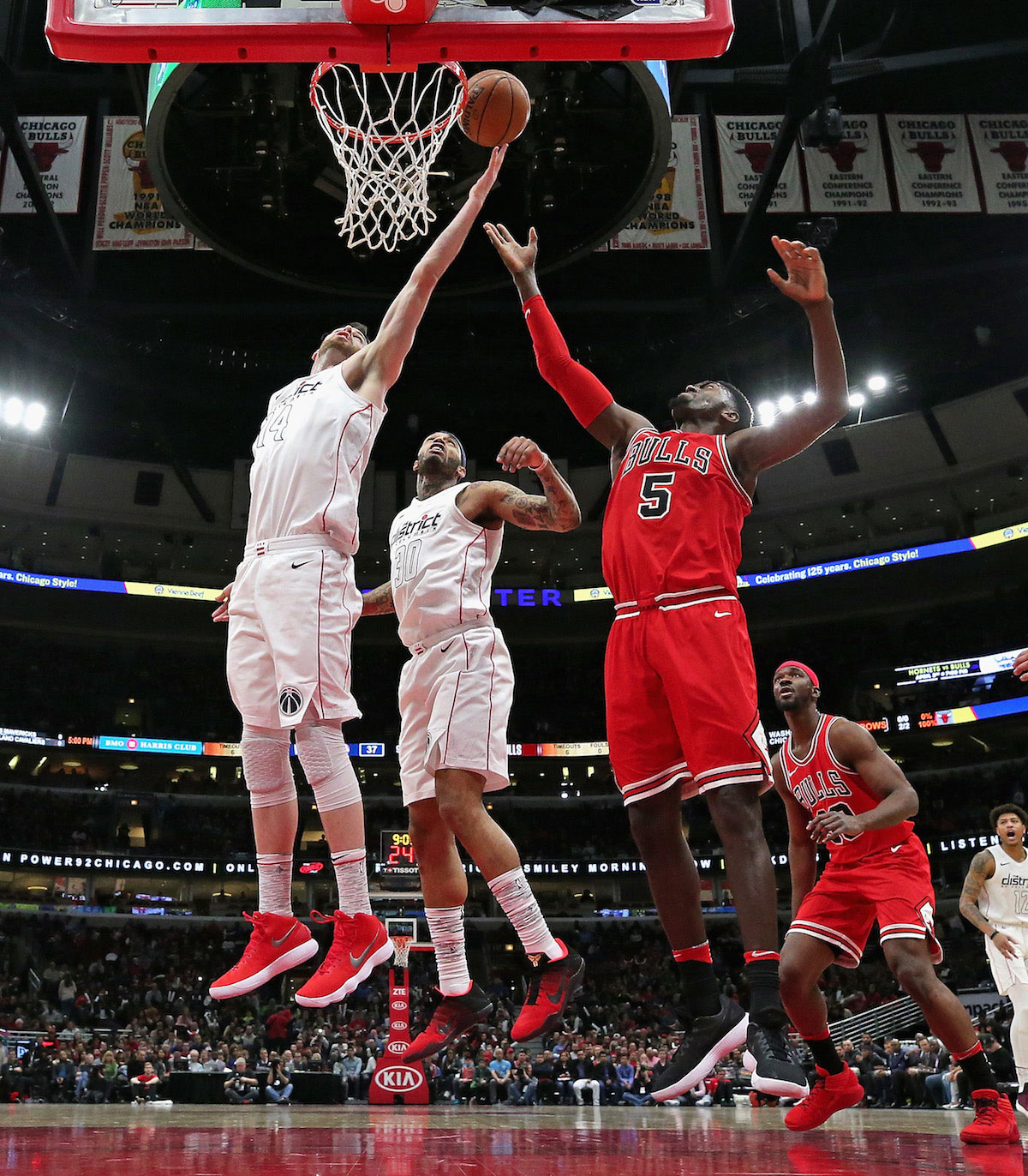 Jason Smith #14 of the Washington Wizards and Bobby Portis #5 of the Chicago Bulls battle fora rebound.