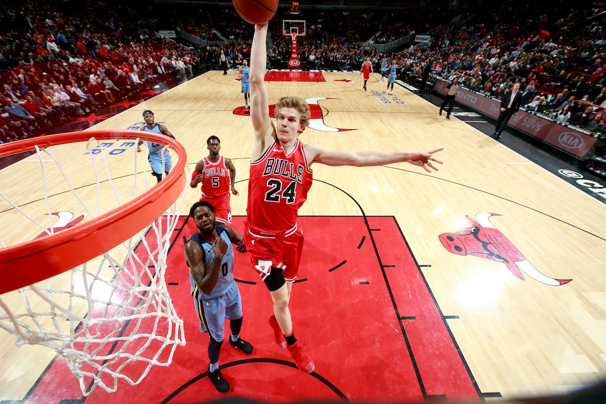 Lauri Markkanen #24 of the Chicago Bulls dunks the ball during the game against the Memphis Grizzlies on March 7, 2018 at United Center in Chicago, Illinois.
