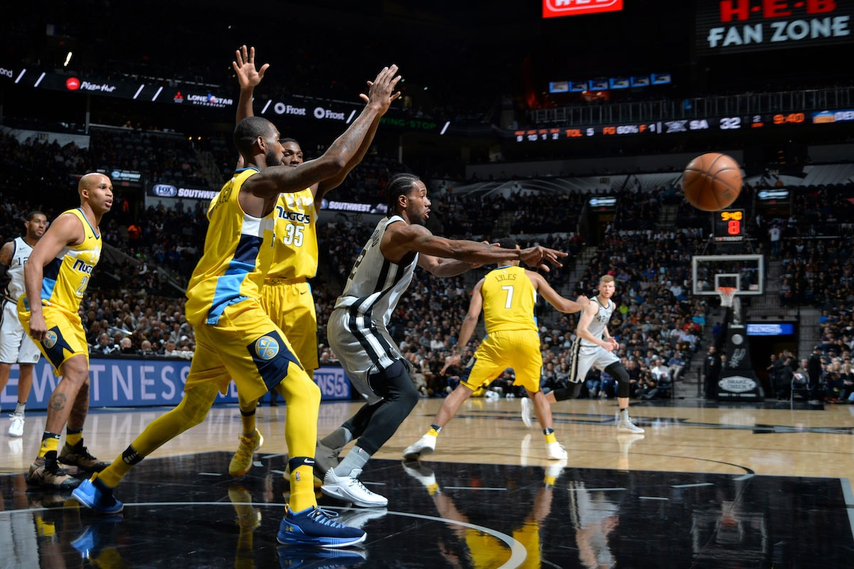 Kawhi Leonard #2 of the San Antonio Spurs handles the ball during the game against the Denver Nuggets on January 13, 2018