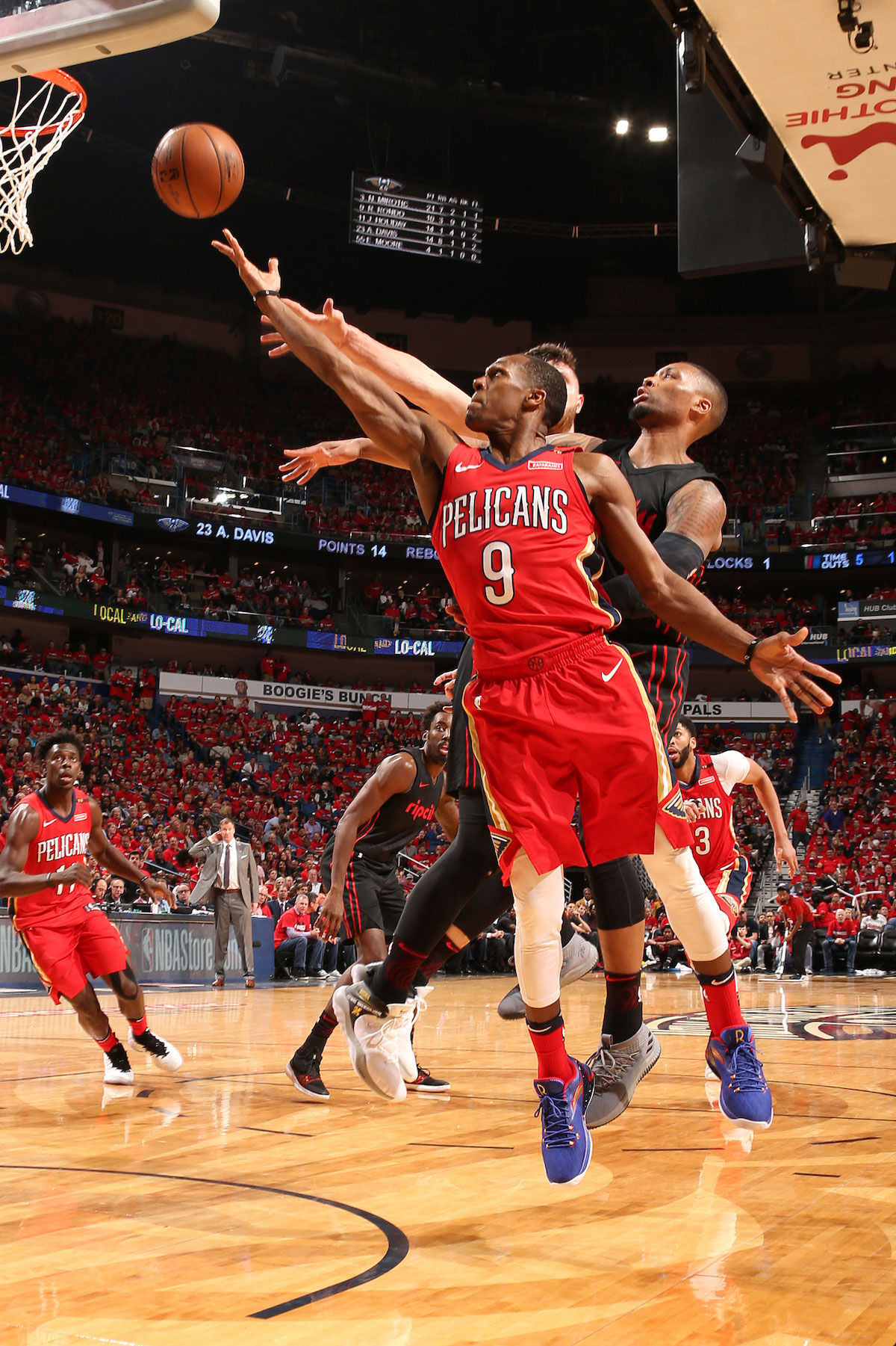 Rajon Rondo #9 of the New Orleans Pelicans shoots the ball against the Portland Trail Blazers in Game Three of Round One of the 2018 NBA Playoffs