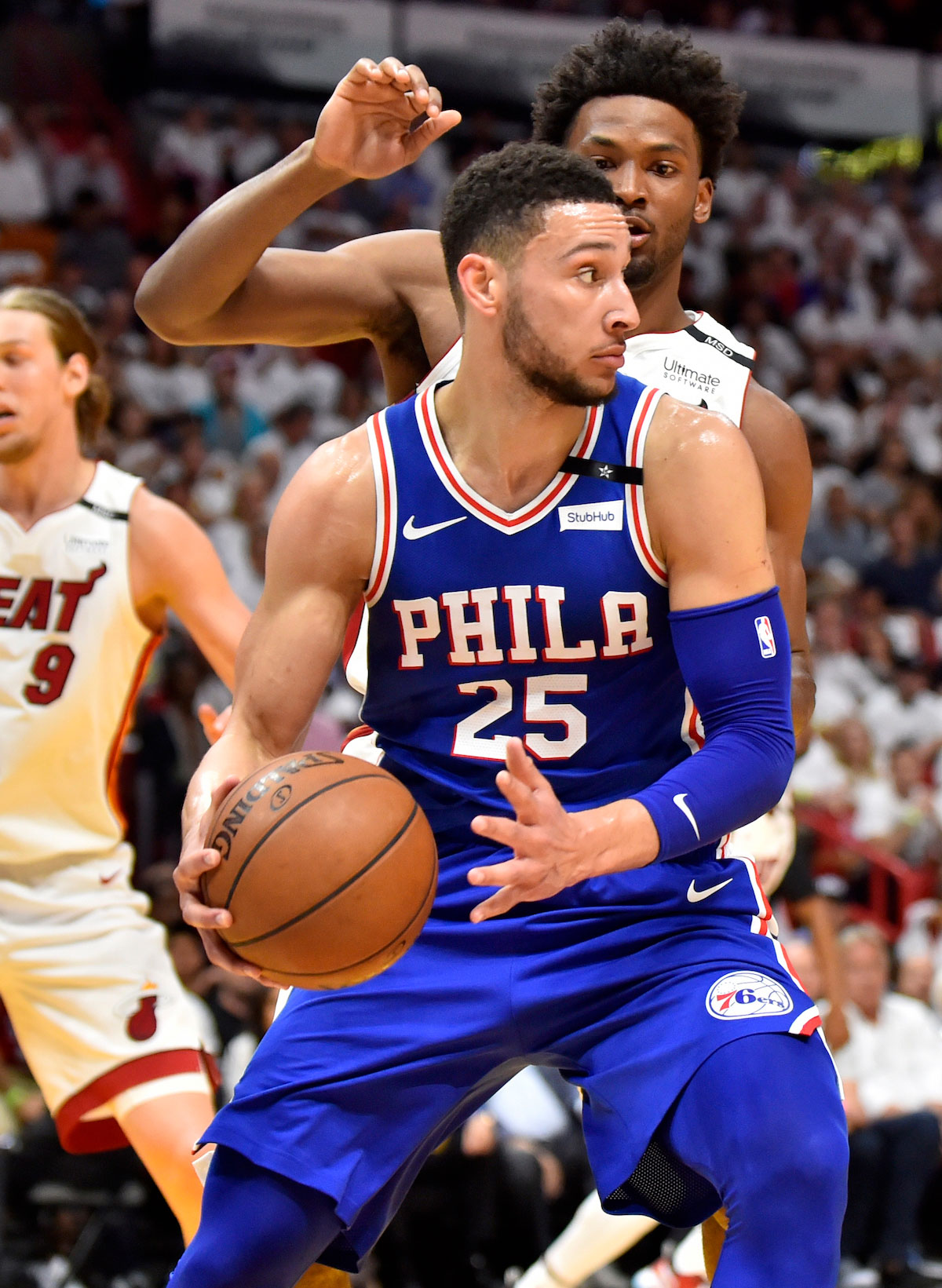 Ben Simmons #25 of the Philadelphia 76ers looks to pass the ball while being defended by Justise Winslow #20 of the Miami Heat
