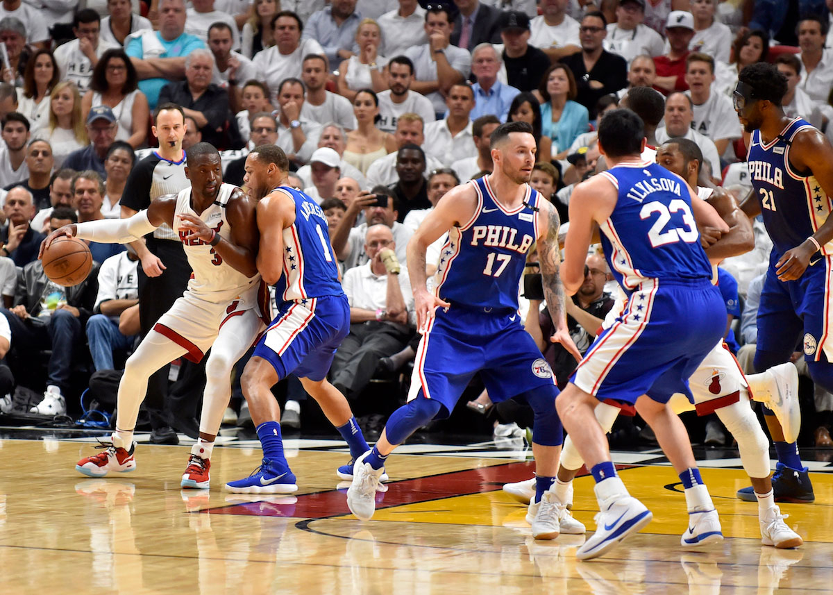 Dwyane Wade #3 of the Miami Heat drives to the basket while bing defended by Justin Anderson #1 of the Philadelphia 76ers