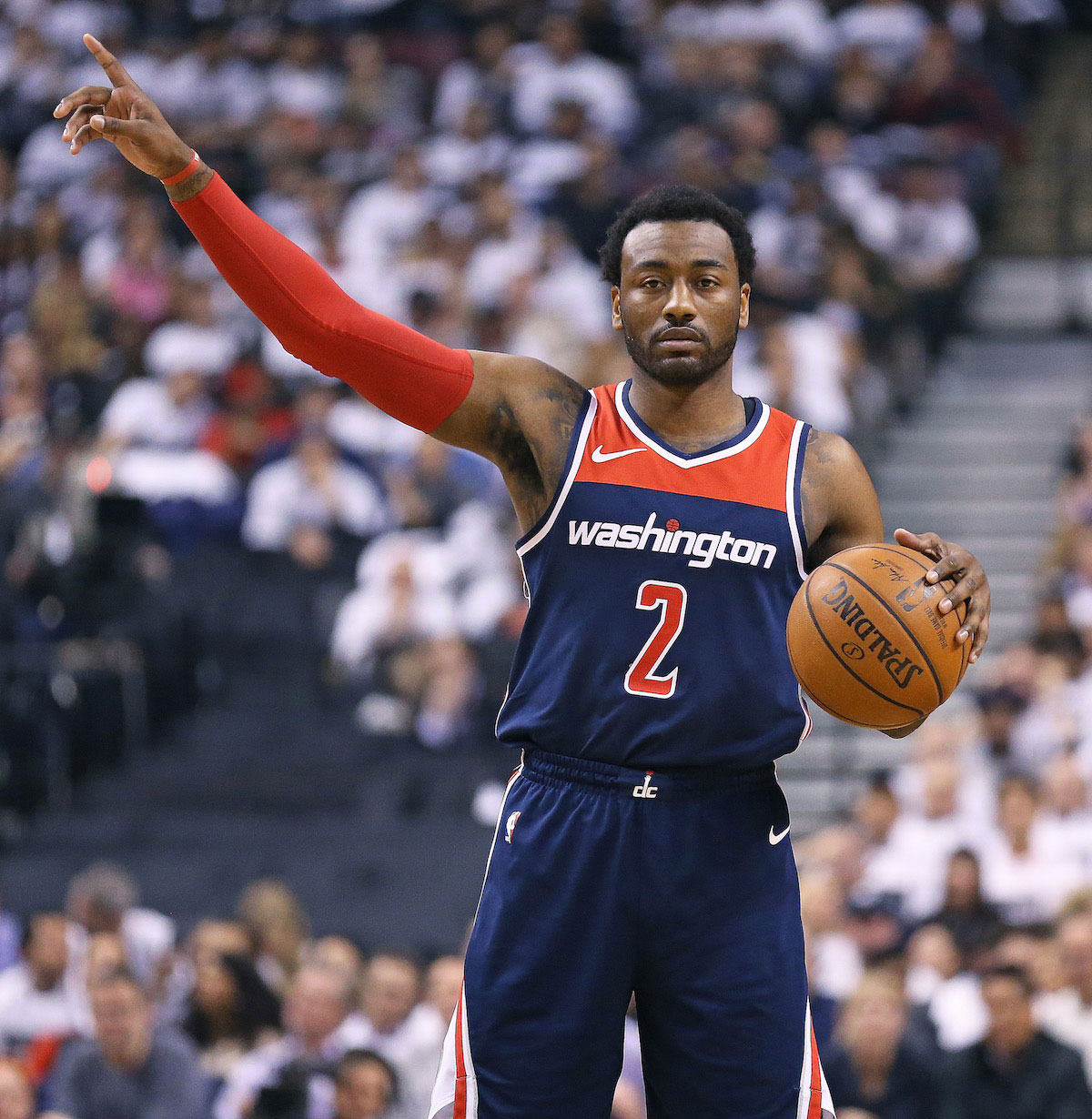 John Wall #2 of the Washington Wizards sets up a play against the Toronto Raptors in Game Two of the Eastern Conference First Round in the 2018