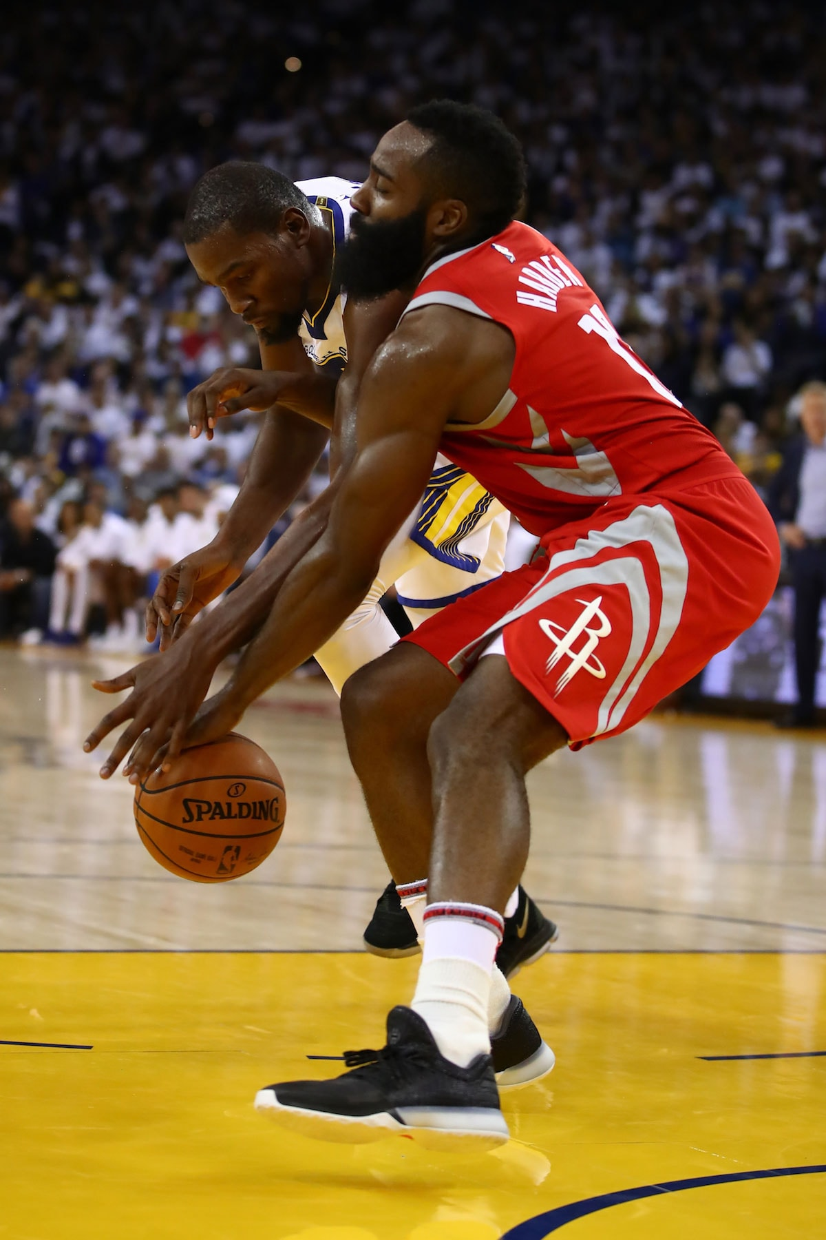 Kevin Durant #35 of the Golden State Warriors defends against James Harden #13 of the Houston Rockets during their NBA game at ORACLE Arena on October 17, 2017 in Oakland, California.