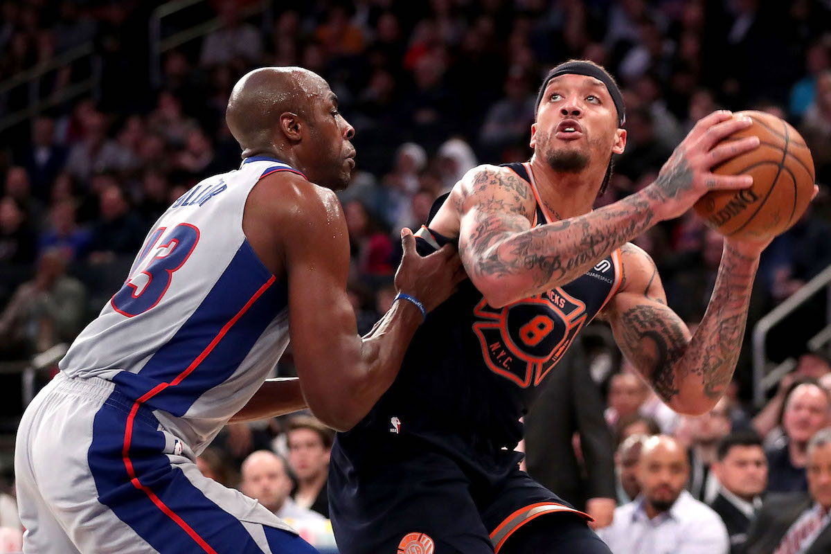 Michael Beasley #8 of the New York Knicks works against Anthony Tolliver #43 of the Detroit Pistons in the third quarter during their game at Madison Square Garden on March 31, 2018 in New York City