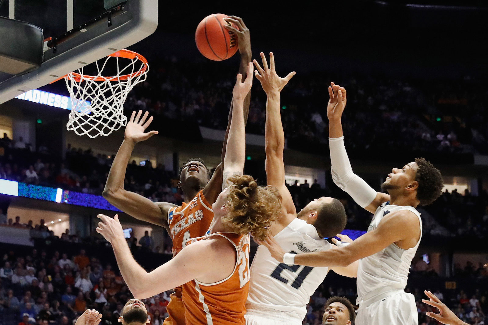 Mohamed Bamba #4 of the Texas Longhorns grabs a rebound over Kendall Stephens #21 of the Nevada Wolf Pack during the game in the first round of the 2018 NCAA Men's Basketball Tournament at Bridgestone Arena on March 16, 2018 in Nashville, Tennessee.