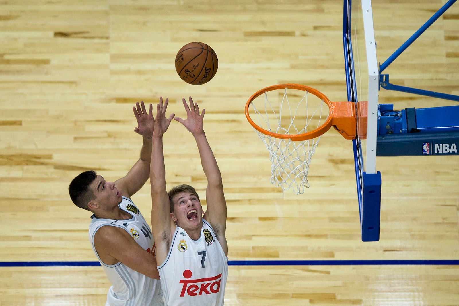 Luka Doncic (R) of Real Madrid and his teammate Guillermo Hernangomez (L) goes up for a rebound during the friendlies of the NBA Global Games 2015 basketball match between Real Madrid and Boston Celtics at Barclaycard Center on October 8, 2015 in Madrid, Spain.