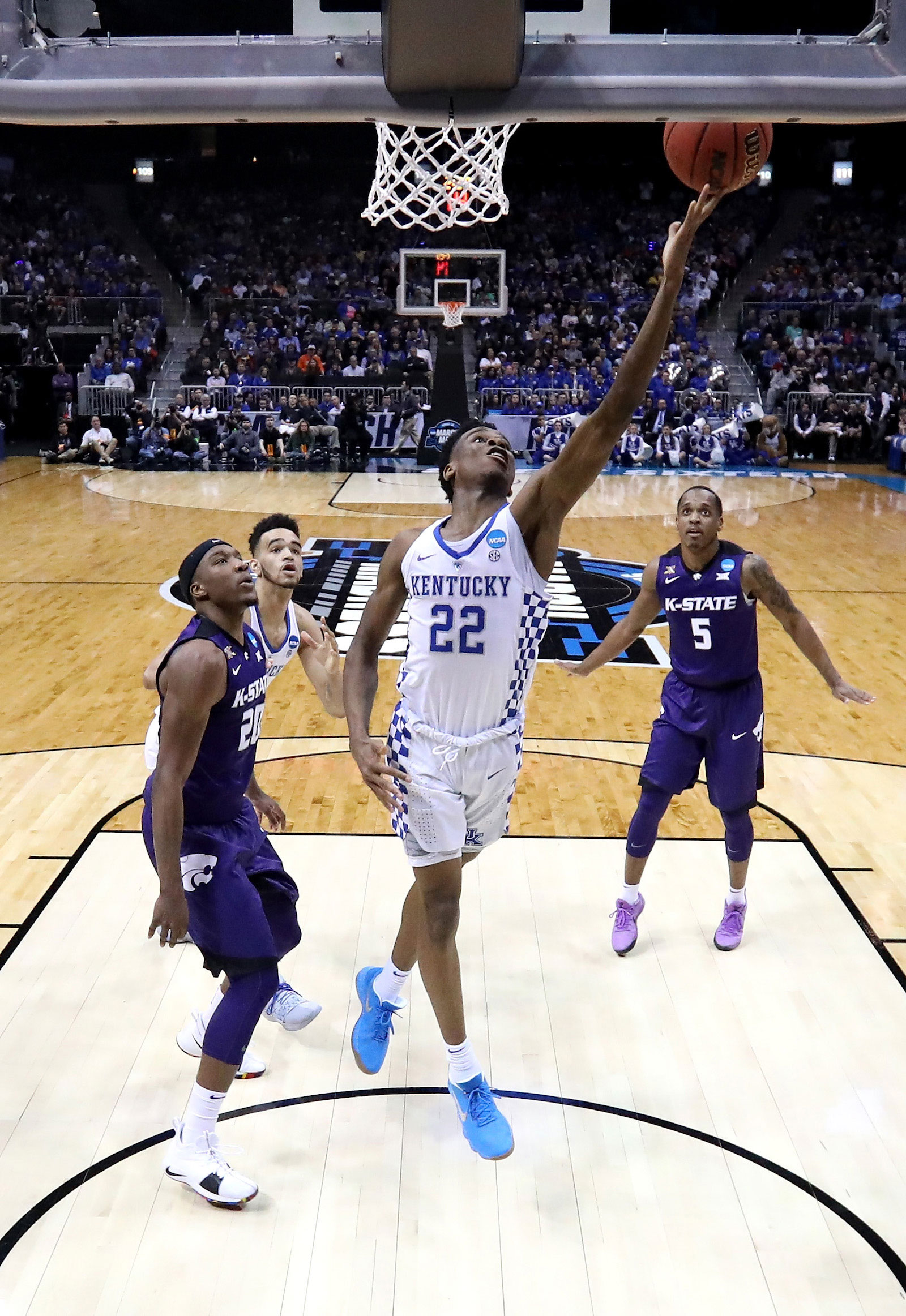 Shai Gilgeous-Alexander #22 of the Kentucky Wildcats shoots against Xavier Sneed #20 of the Kansas State Wildcats in the first half during the 2018 NCAA Men's Basketball Tournament South Regional at Philips Arena on March 22, 2018 in Atlanta, Georgia.