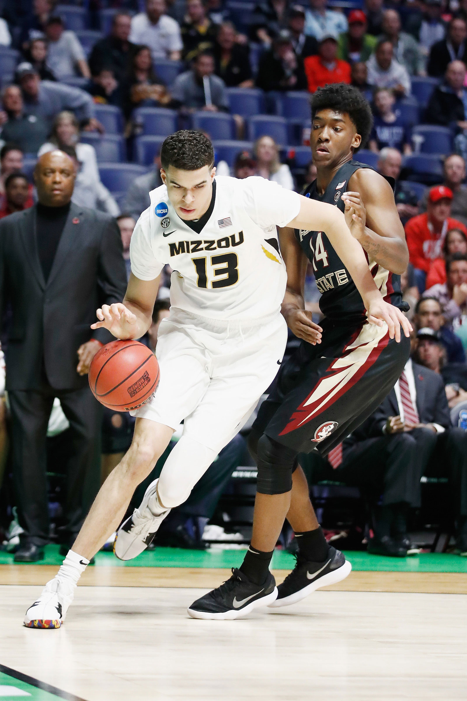 Michael Porter Jr. #13 of the Missouri Tigers drives to the basket against Terance Mann #14 of the Florida State Seminoles during the game in the first round of the 2018 NCAA Men's Basketball Tournament at Bridgestone Arena on March 16, 2018 in Nashville, Tennessee.