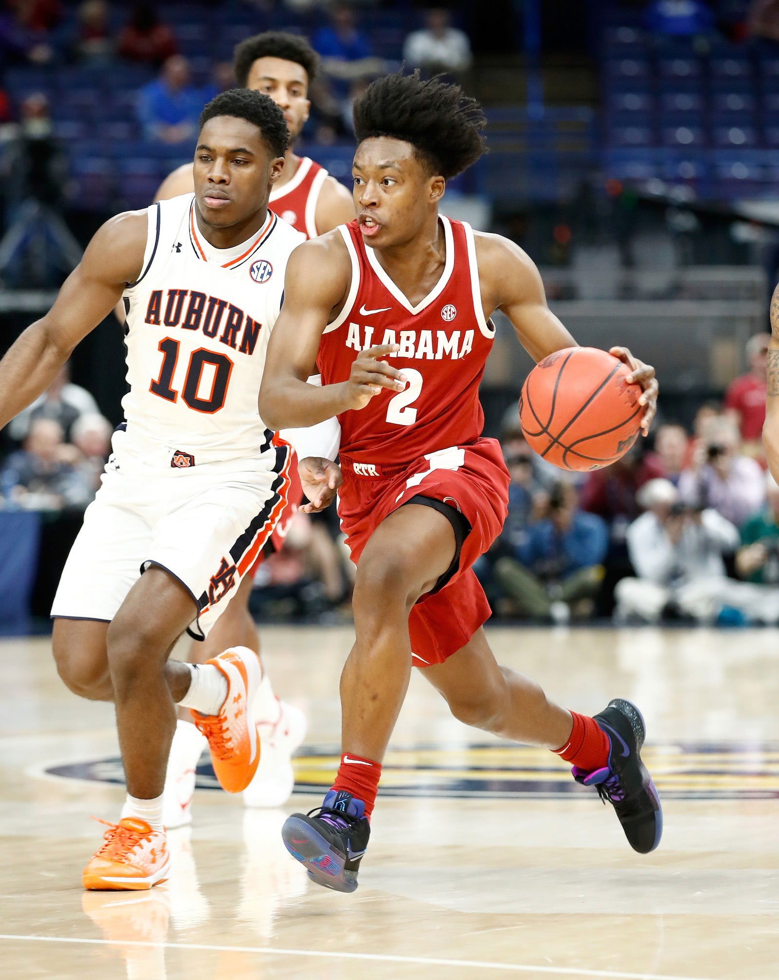 Collin Sexton #2 of the Alabama Crimson Tide dribbles the ball against the Auburn Tigers during the quarterfinals round of the 2018 SEC Basketball Tournament at Scottrade Center on March 9, 2018 in St Louis, Missouri.