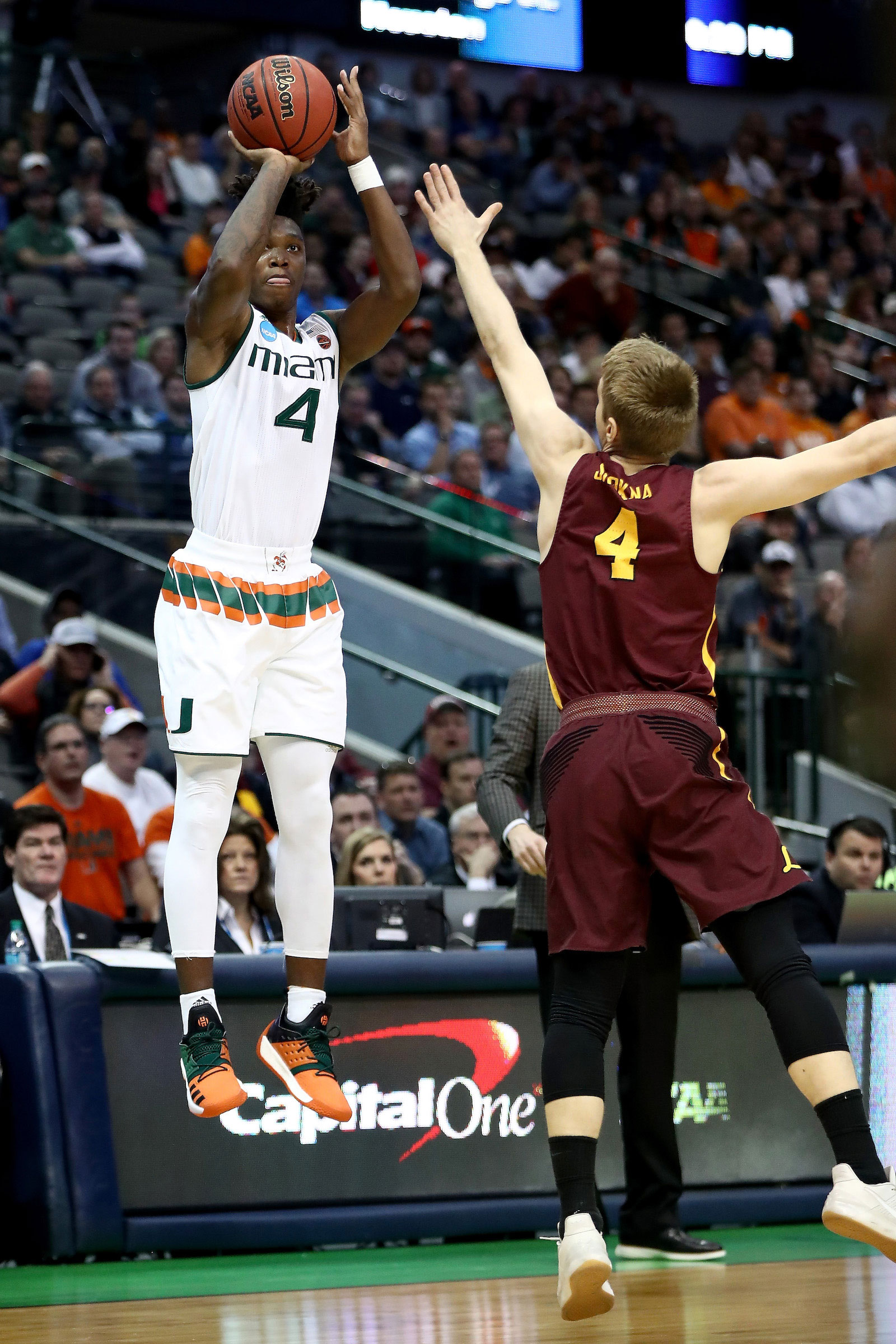 Lonnie Walker IV #4 of the Miami Hurricanes shots over Bruno Skokna #4 of the Loyola Ramblers in the first half in the first round of the 2018 NCAA Men's Basketball Tournament at American Airlines Center on March 15, 2018 in Dallas, Texas.