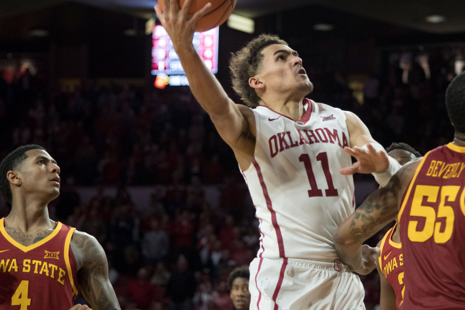 Oklahoma Sooners guard Trae Young #11 shoots over an Iowa State player during the second half of a NCAA college basketball game at the Lloyd Noble Center on March 2, 2018 in Norman, Oklahoma.