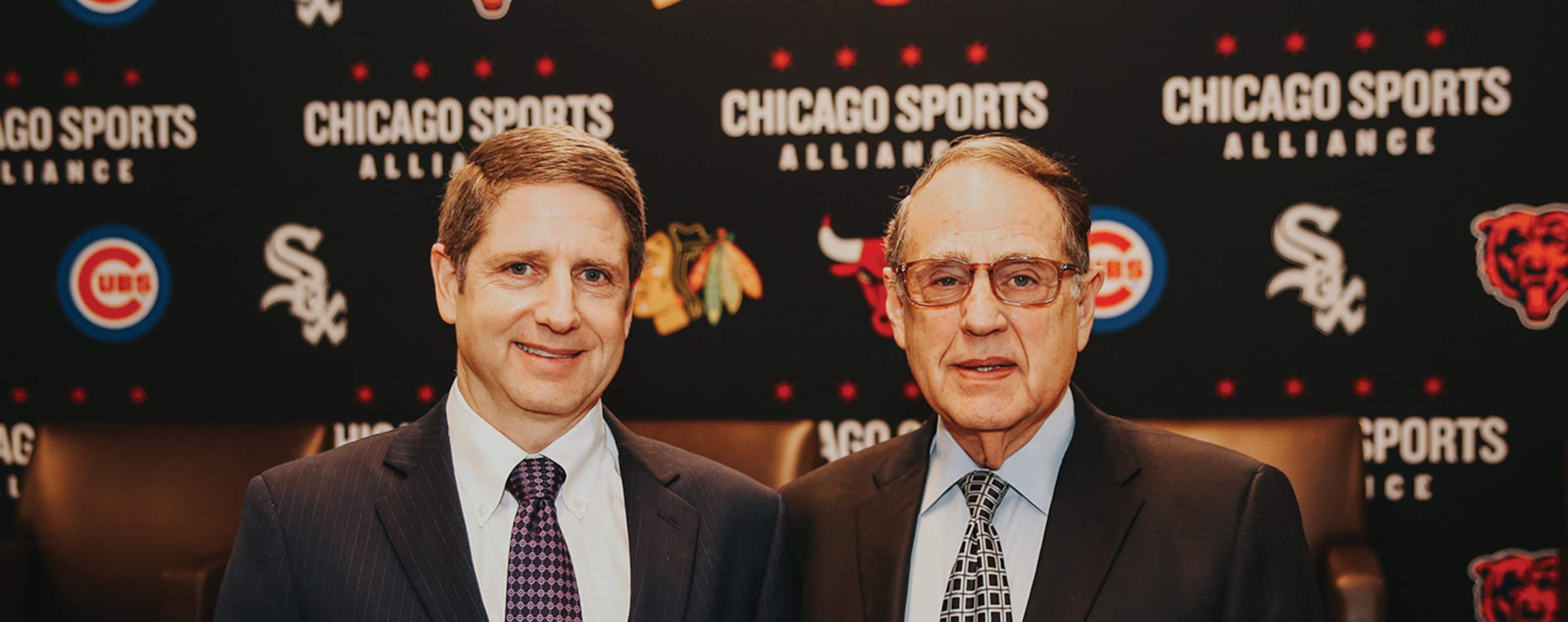Jerry Reinsdorf (right) alongside his son, Michael Reinsdorf, President and Chief Operating Officer of the Chicago Bulls, at a Chicago Sports Alliance event