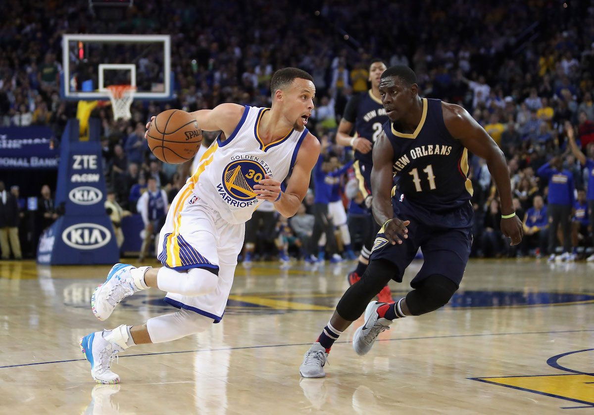 Stephen Curry #30 of the Golden State Warriors drives on Jrue Holiday #11 of the New Orleans Pelicans at ORACLE Arena on March 14, 2016 in Oakland, California.