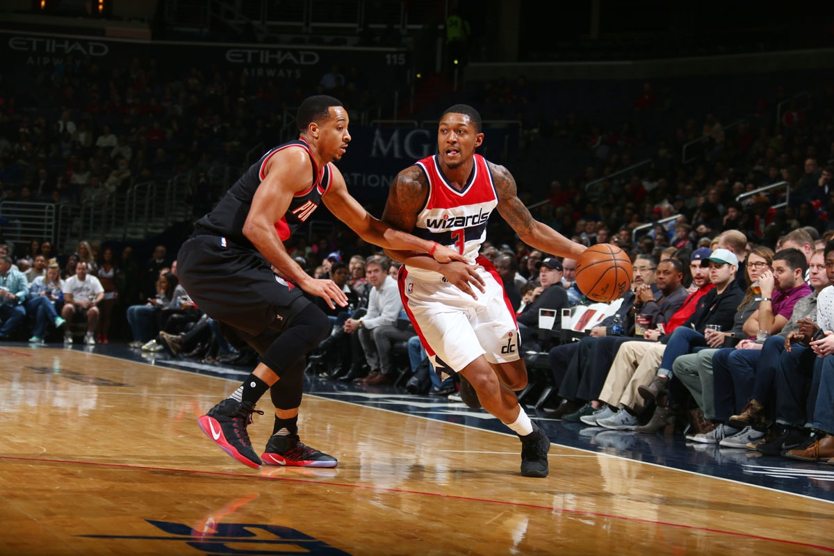 Bradley Beal #3 of the Washington Wizards drives to the basket against C.J. McCollum #3 of the Portland Trail Blazers during the game on January 16, 2017 at Verizon Center in Washington, DC.