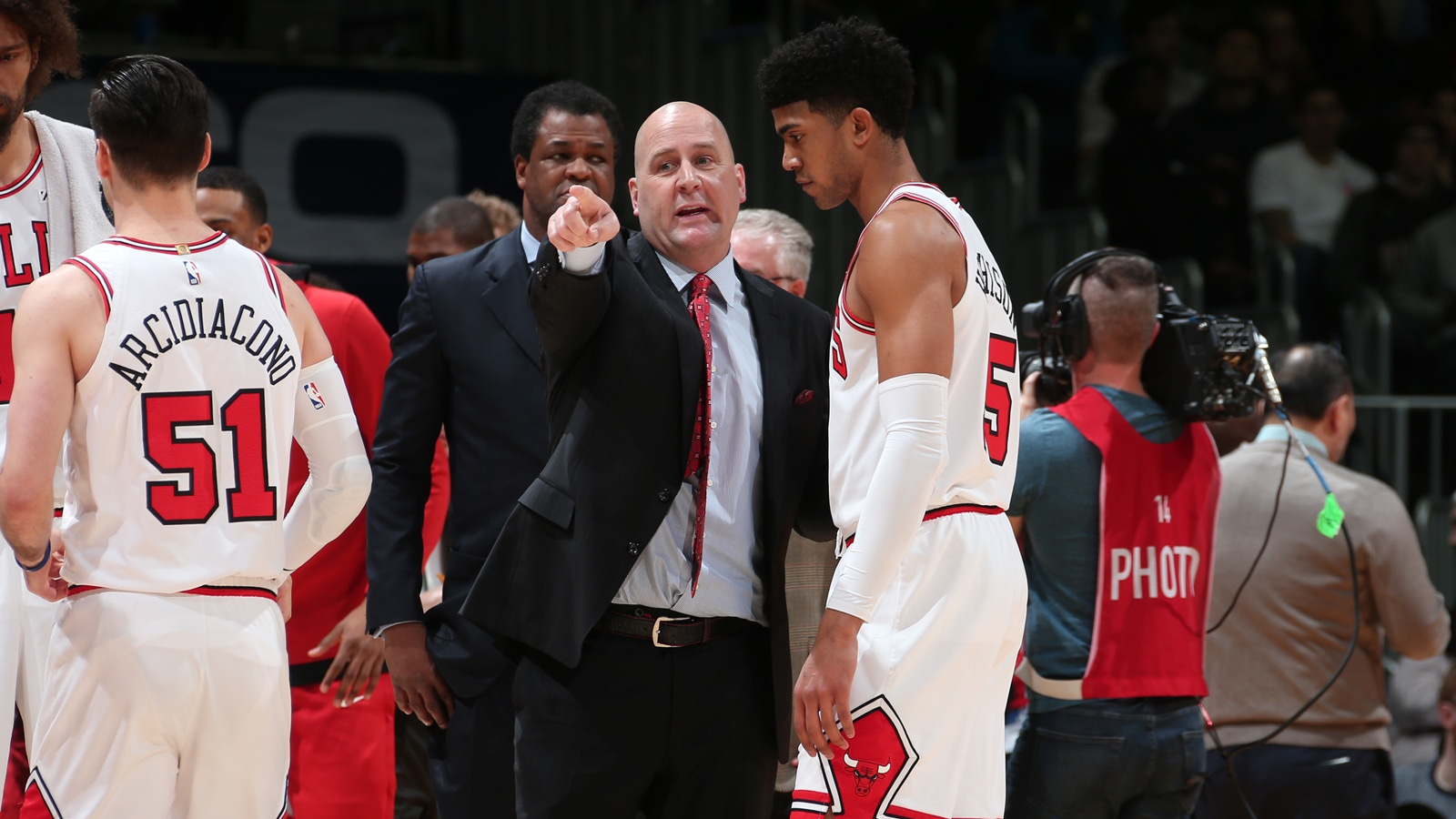 Head Coach Jim Boylen talks with Chandler Hutchison #15 of the Chicago Bulls during the game against the Washington Wizards on December 28, 2018 at Capital One Arena in Washington, DC.