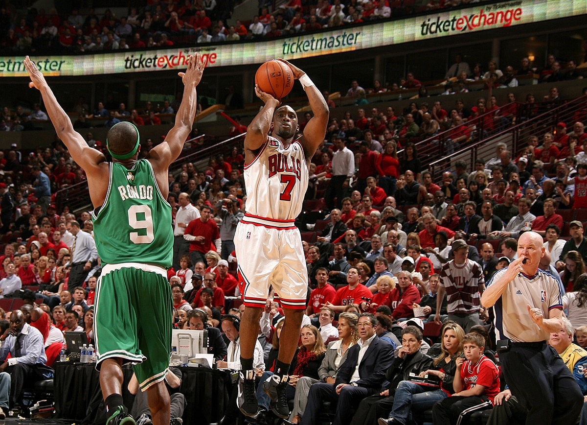 Ben Gordon of the Chicago Bulls shoots the Ball over Rajon Rondo of the Boston Celtics