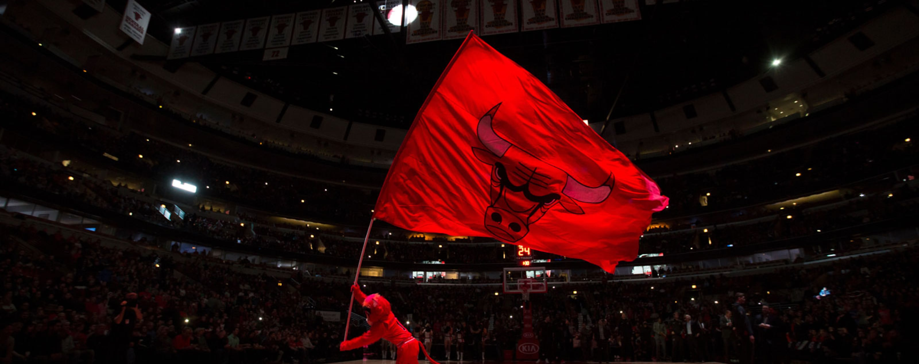 Benny the Bull running with the flag