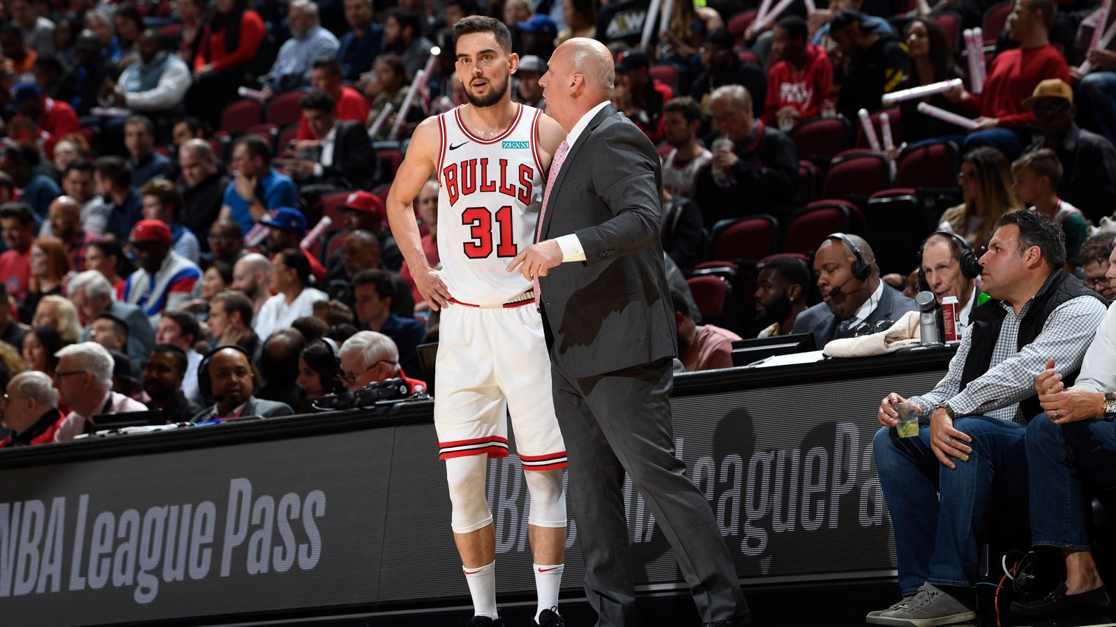 Tomas Satoransky and Coach Boylen discussing plays on the sidelines