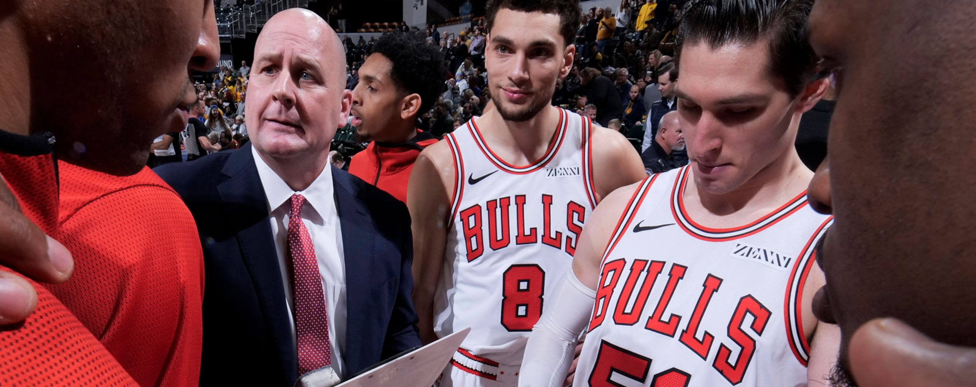 Jim Boylen and the Chicago Bulls in a huddle.