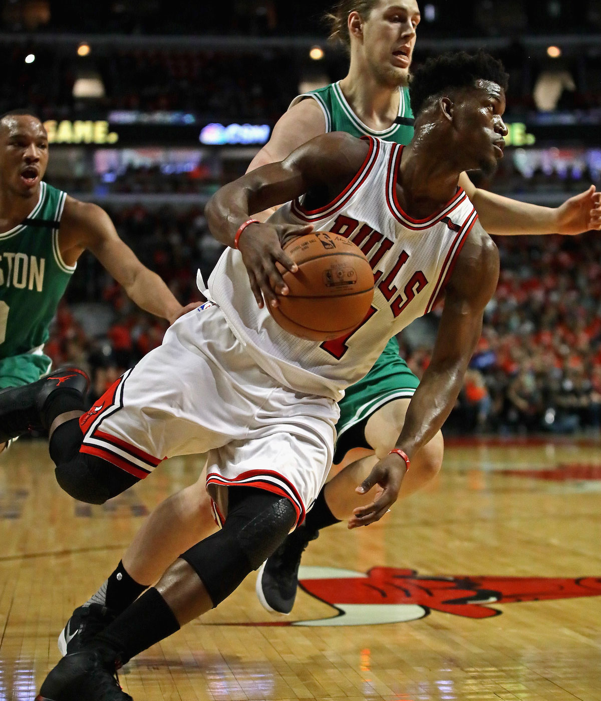 Jimmy Butler #21 of the Chicago Bulls drives around Kelly Olynyk #41 of the Boston Celtics