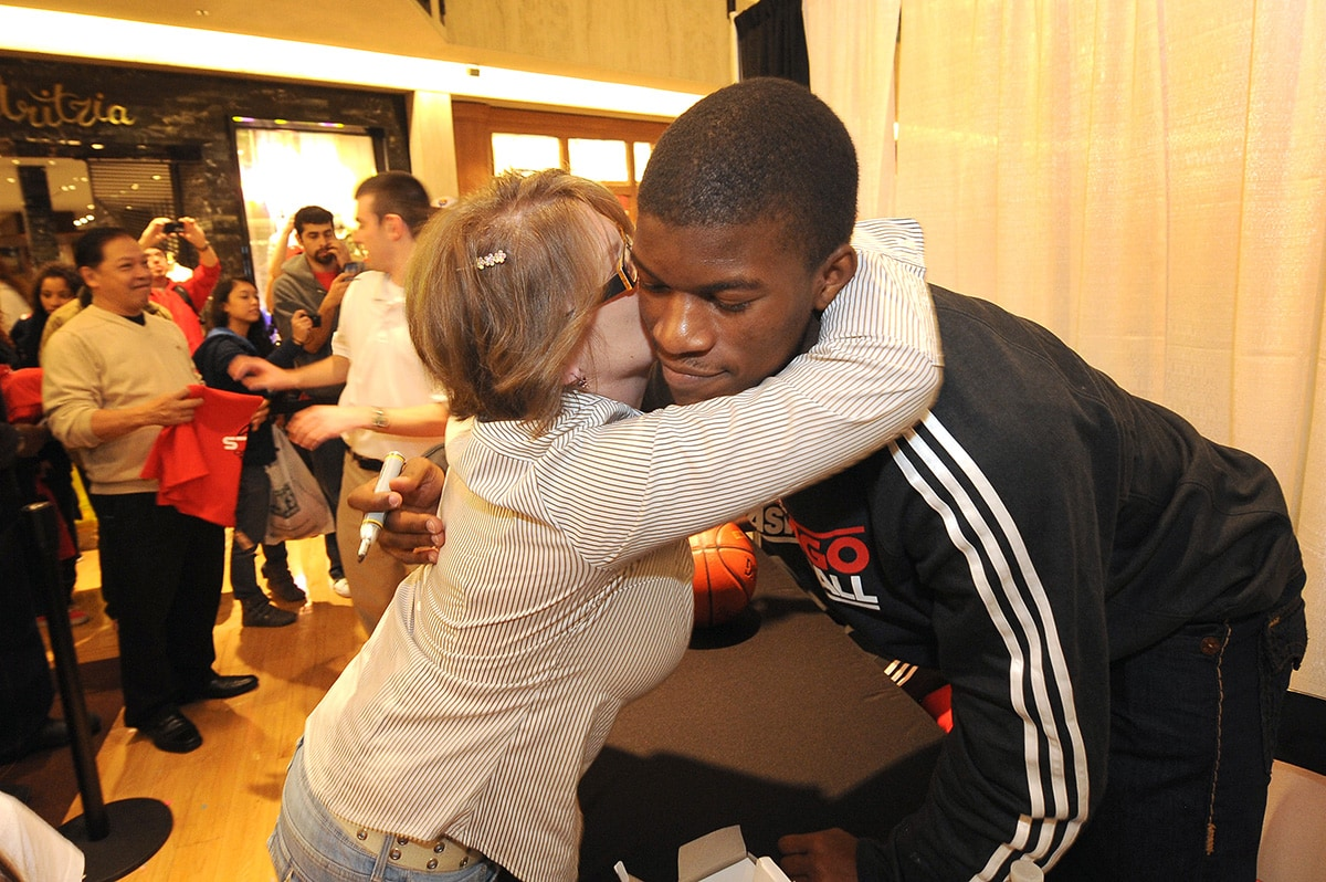 Jimmy Butler hugging a fan at the Bulls' 'Paint the Town' Community Event