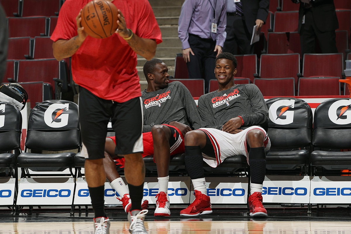 Jimmy Butler talks with Luol Deng