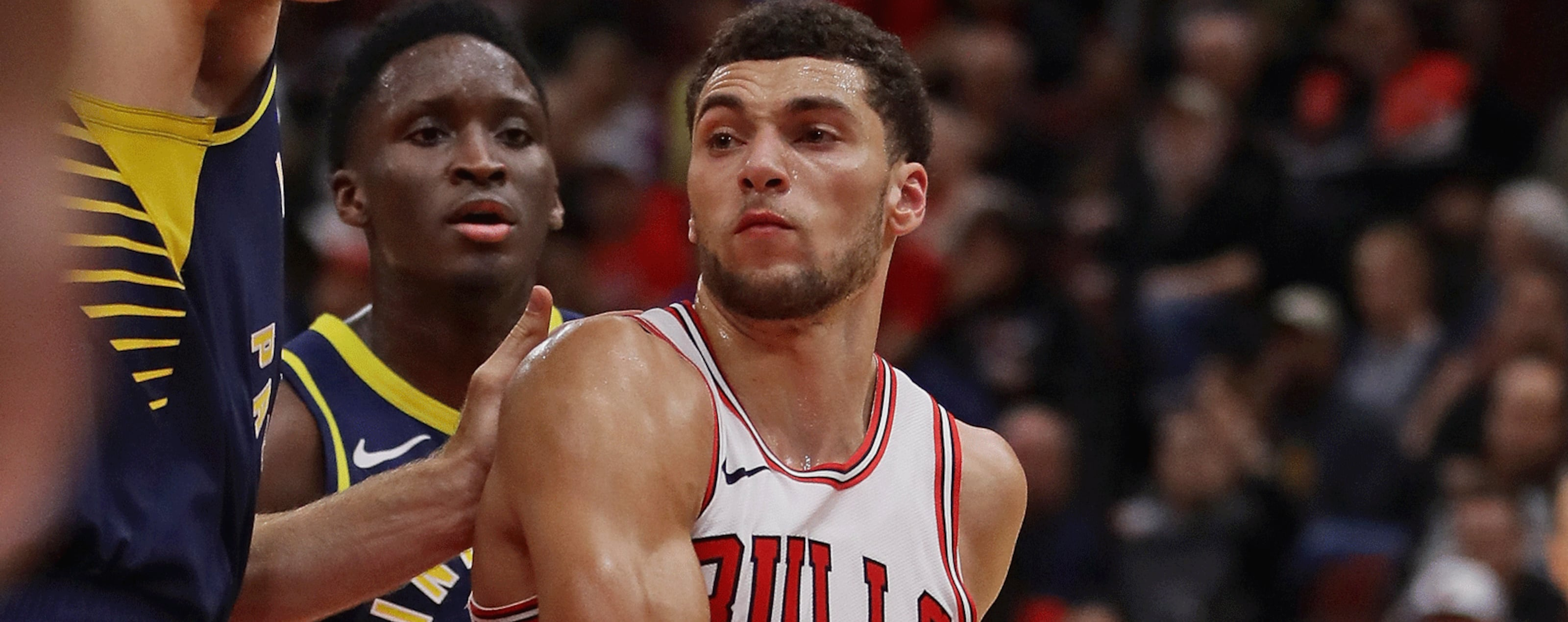 : Zach LaVine #8 of the Chicago Bulls drives against Domantas Sabonis #11 of the Indiana Pacers during a preseason game at the United Center on October 10, 2018 in Chicago, Illinois.