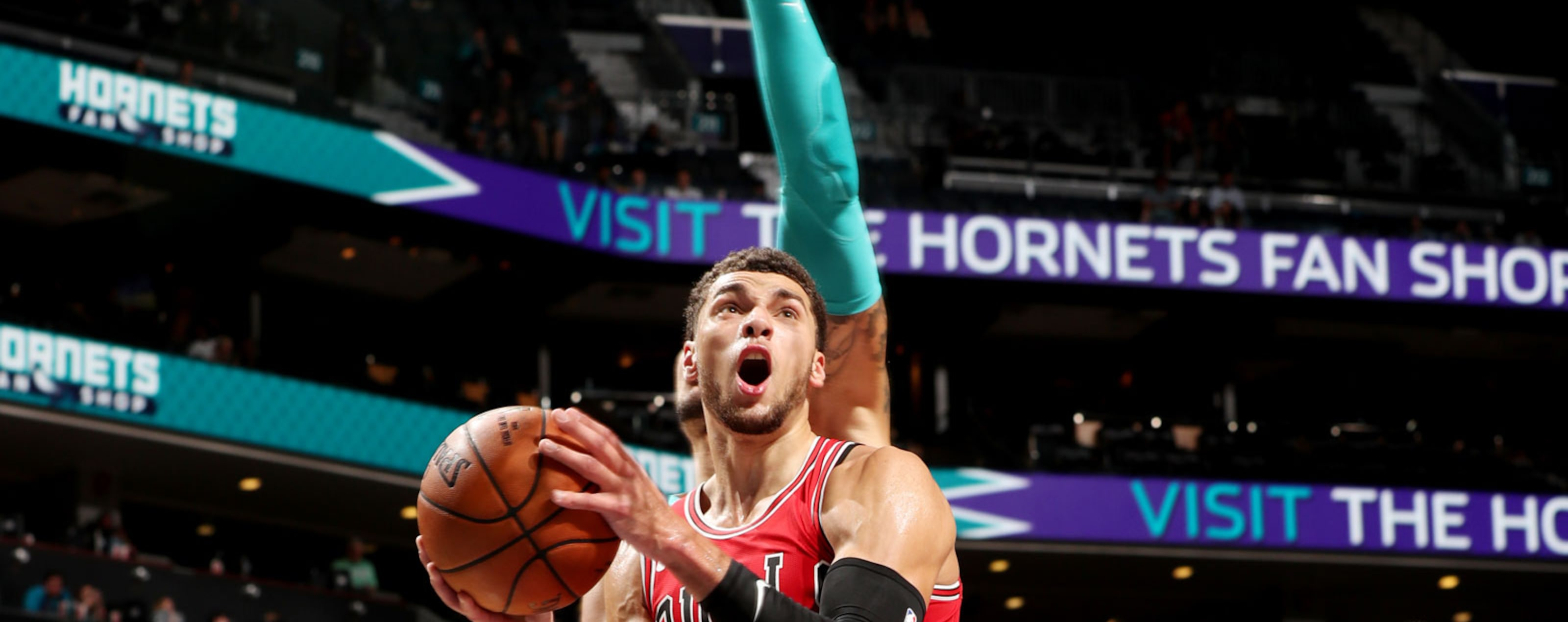 Zach LaVine #8 of the Chicago Bulls shoots the ball against the Charlotte Hornets during a pre-season game on October 8, 2018 at Spectrum Center in Charlotte, North Carolina.