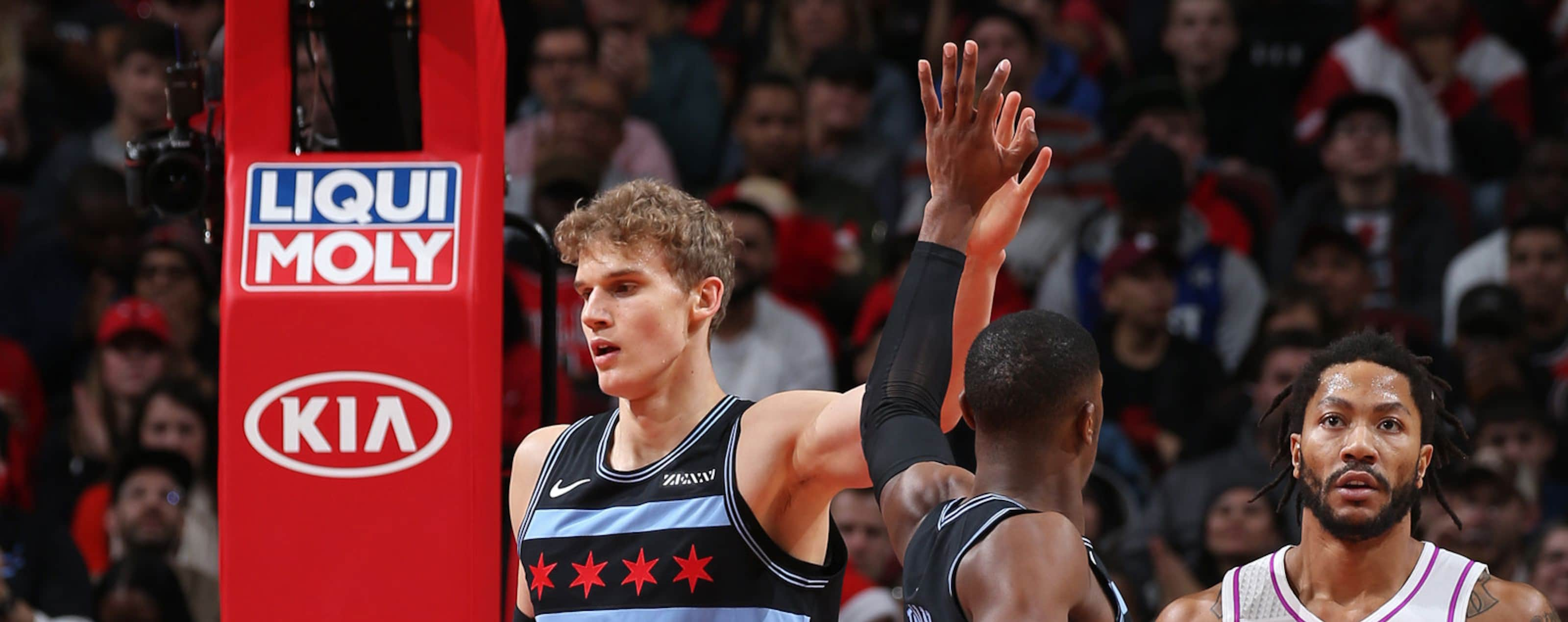 Lauri Markkanen #24 high fives teammate Kris Dunn #32 of the Chicago Bulls during the game against the Minnesota Timberwolves on December 26, 2018 at the United Center in Chicago, Illinois.