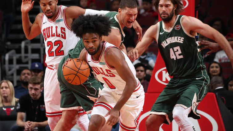 Coby White dribbles down the court vs. The Bucks