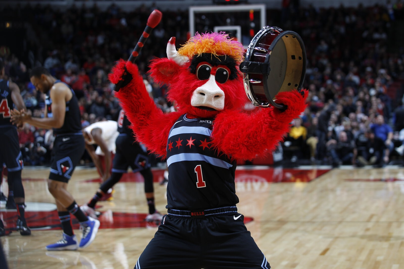 Benny plays a drum to start the game