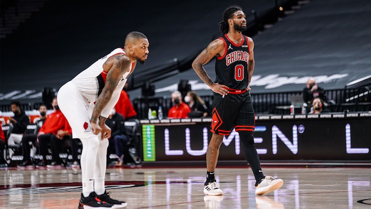 Coby White and Damian Lillard on court