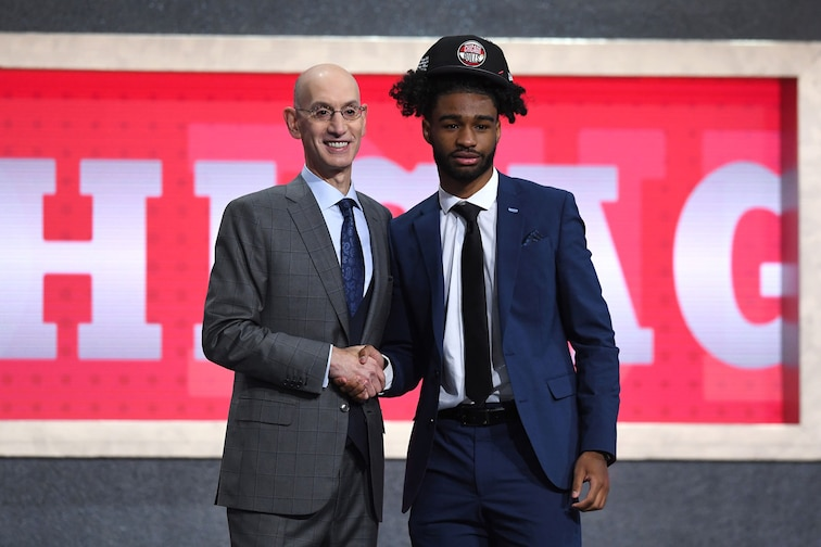 Coby White and NBA Commissioner Adam Silver at the 2019 NBA Draft.