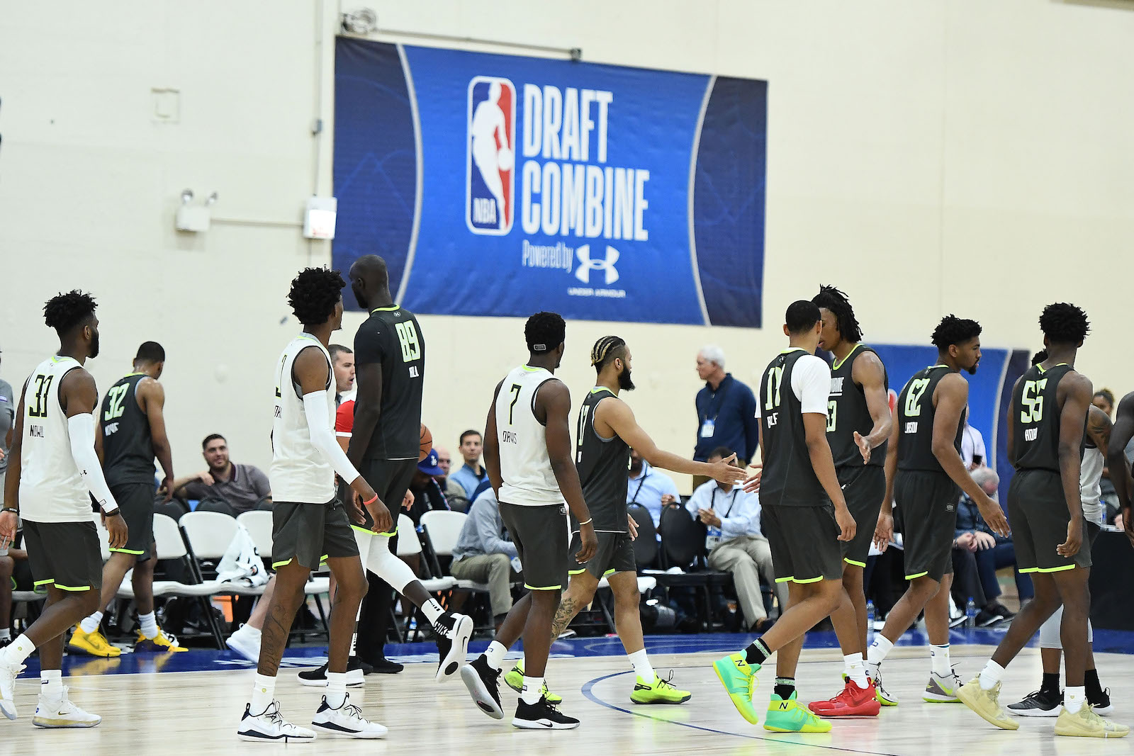Players shake hands following a game during the NBA Draft Combine