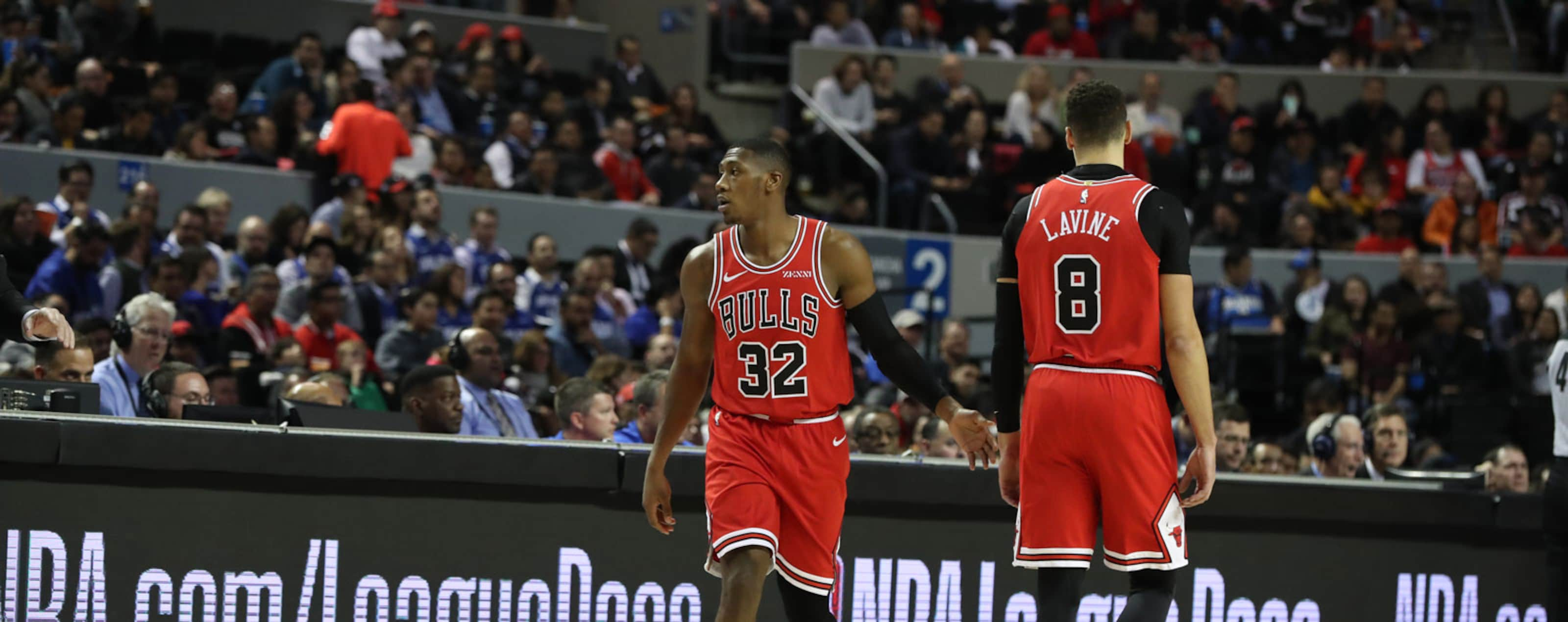 Kris Dunn and Zach LaVine walking past each other during the NBA Mexico City game against the Orlando Magic.