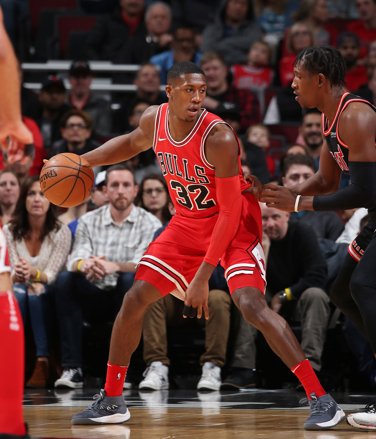 Kris Dunn #32 of the Chicago Bulls handles the ball against the Miami Heat on November 26, 2017 at the United Center in Chicago, Illinois.