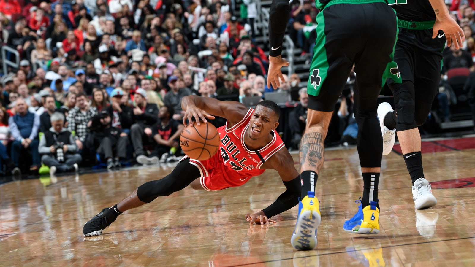 Kris Dunn hustles for the ball against the Celtics