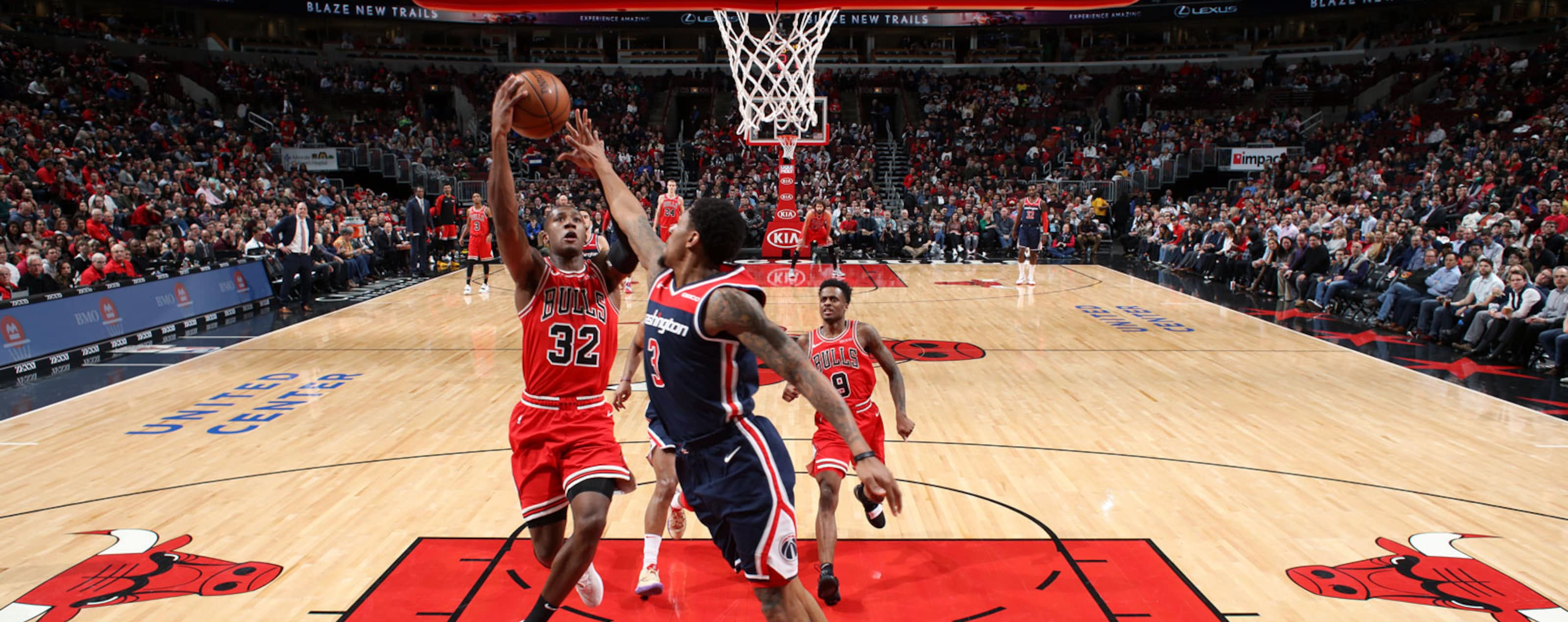 Kris Dunn #32 of the Chicago Bulls goes to the basket against the Washington Wizards on March 20, 2019 at the United Center in Chicago, Illinois.