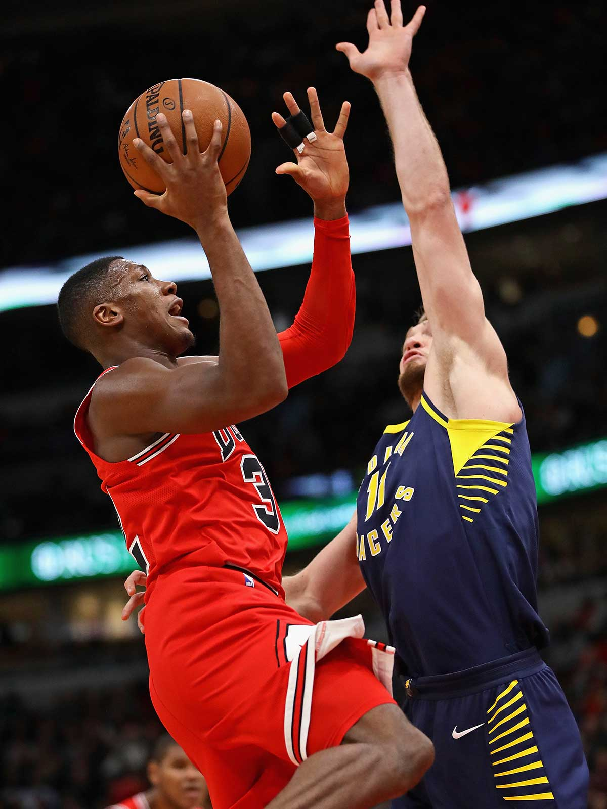 Kris Dunn #32 of the Chicago Bulls drievs to the basket against Domantas Sabonis #11 of the Indiana Pacers at the United Center on November 10, 2017 in Chicago, Illinois.