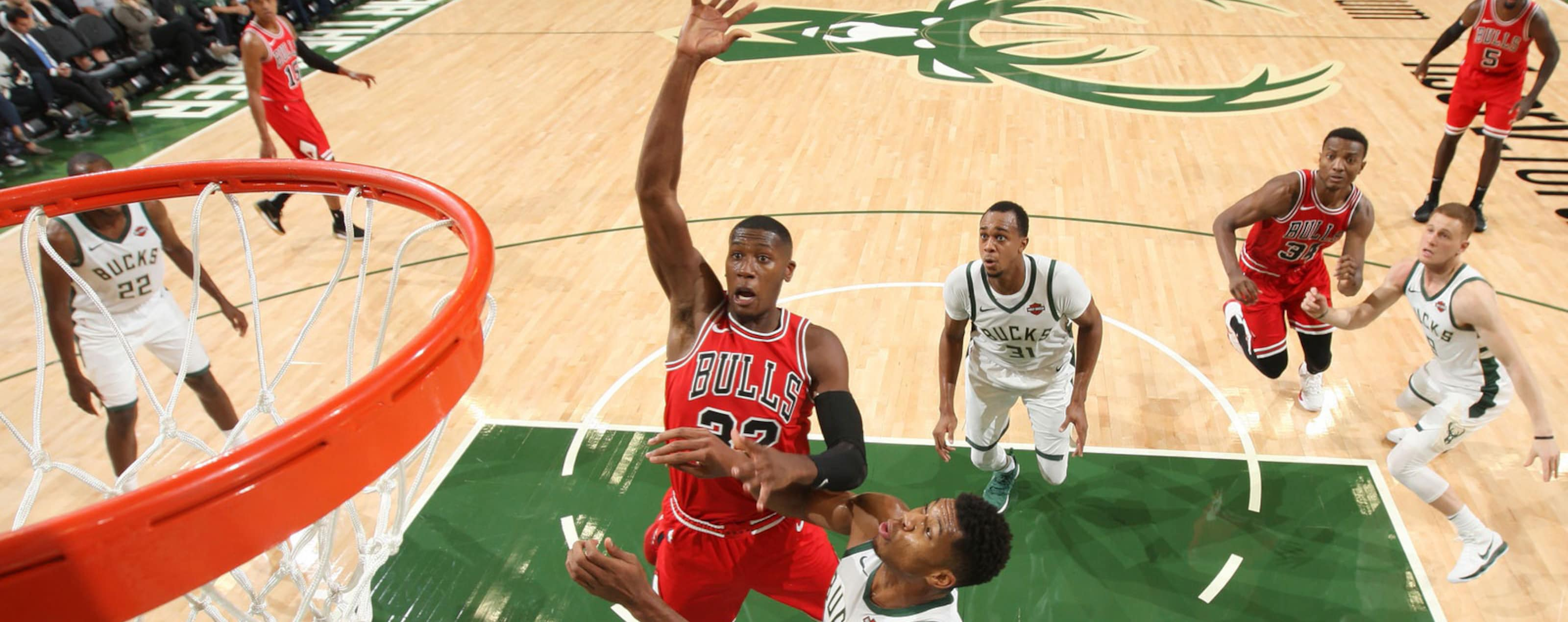 Kris Dunn #32 of the Chicago Bulls shoots the ball against the Milwaukee Bucks during a pre-season game on October 3, 2018 at Fiserv Forum, in Milwaukee, Wisconsin.