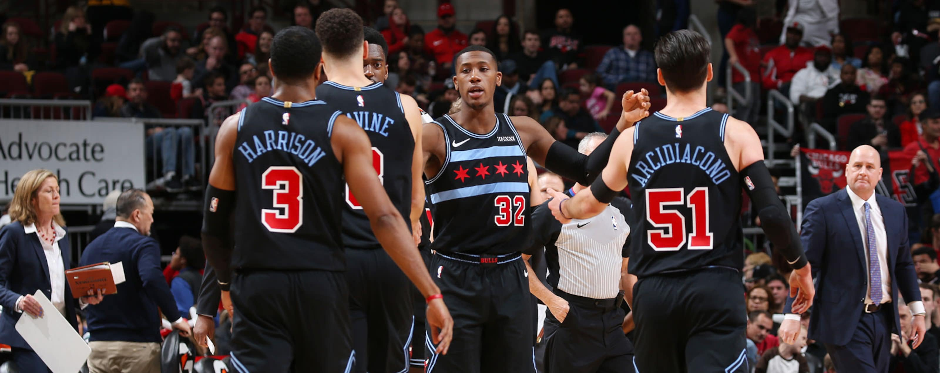 Kris Dunn #32 of the Chicago Bulls greets his team during the game against the Brooklyn Nets on January 6, 2019 at the United Center in Chicago, Illinois.