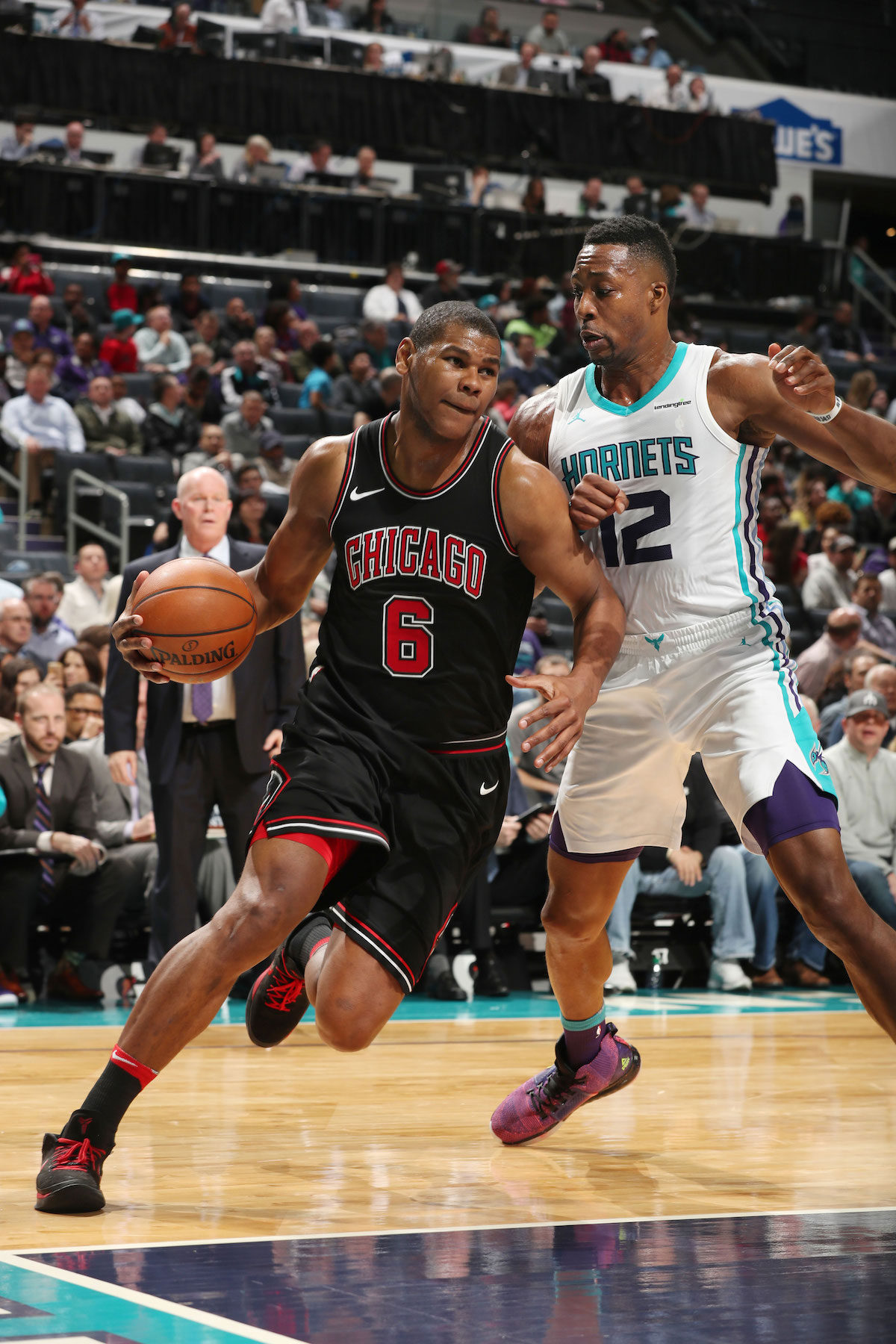 Cristiano Felicio #6 of the Chicago Bulls handles the ball against the Charlotte Hornets on February 27, 2018 at Spectrum Center in Charlotte, North Carolina.
