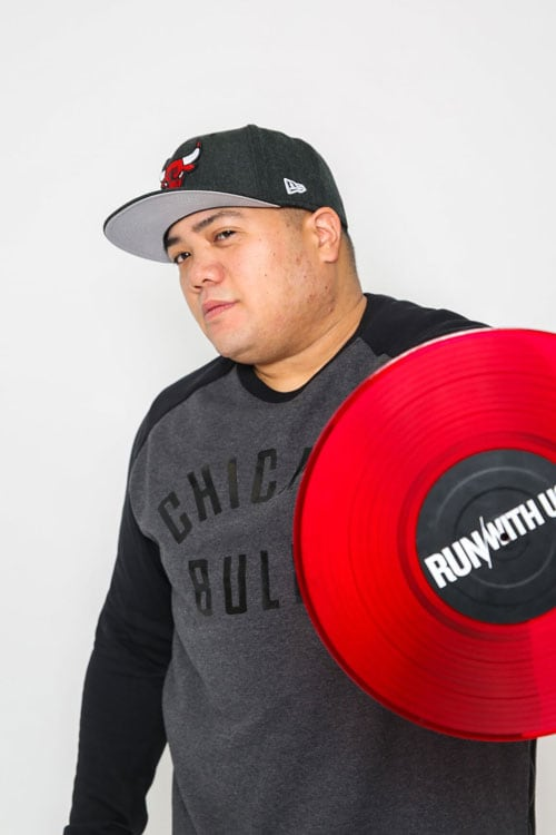 Photo of DJ Jay Funk posing with a red record