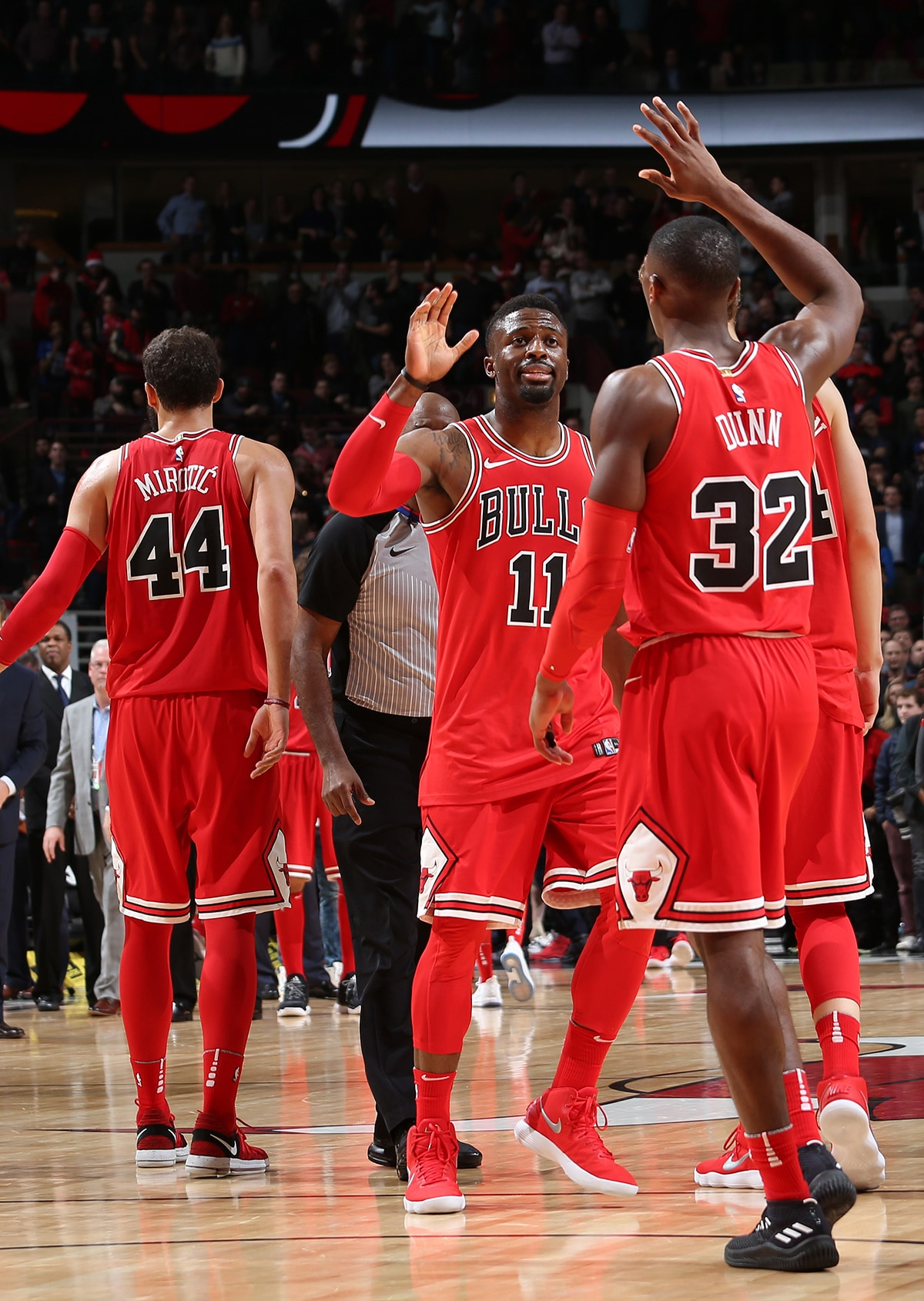 Kris Dunn and David Nwaba of the Chicago Bulls high-five during the Bulls game against the Orlando Magic at the United Center on December 20, 2017 in Chicago, Illinois.
