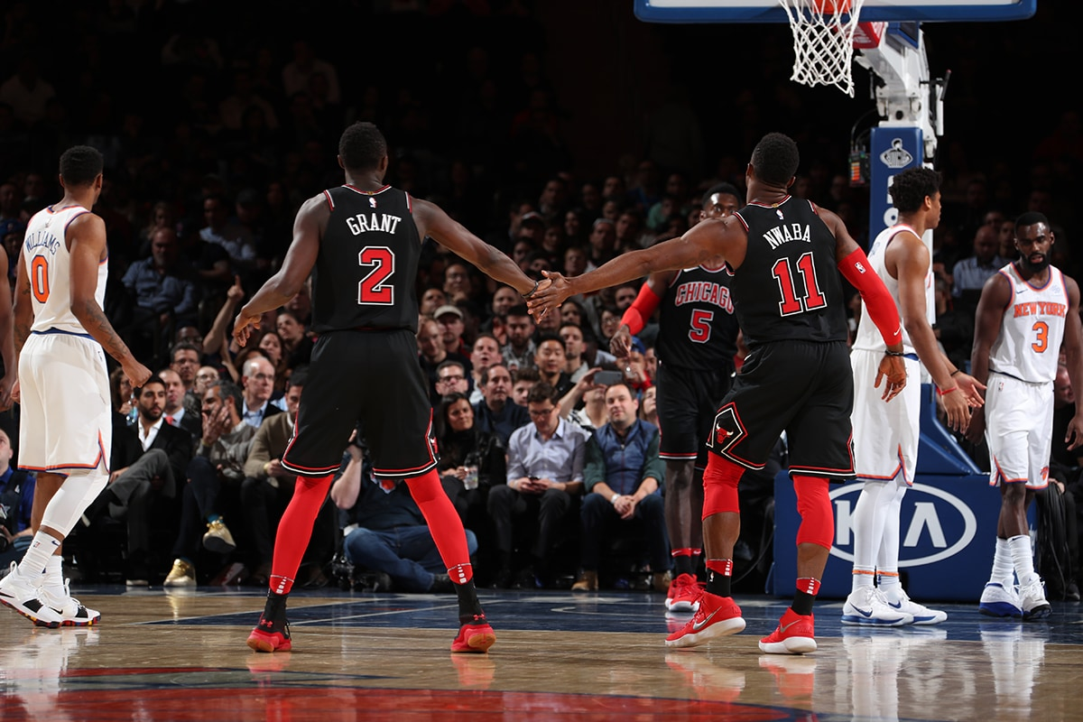Jerian Grant and David Nwaba of the Chicago Bulls share a high-five