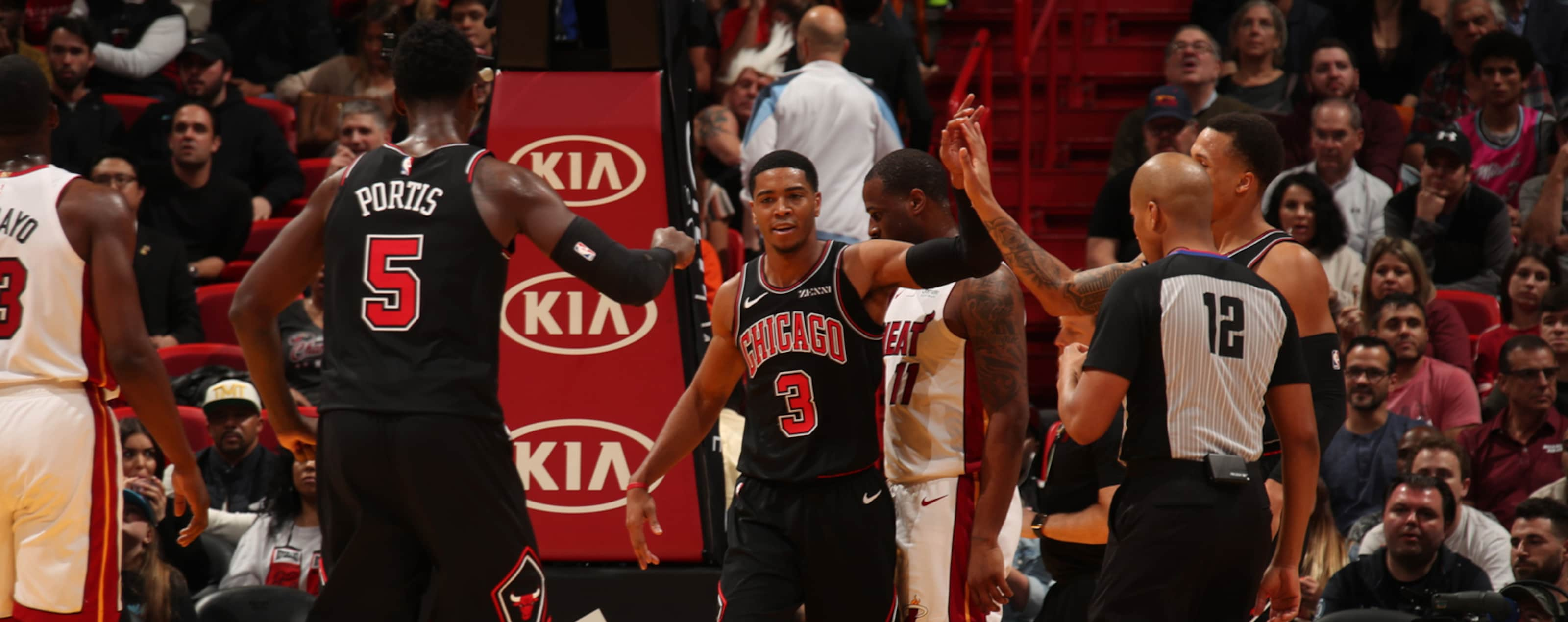 Shaquille Harrison and Bobby Portis celebrating against the Miami Heat