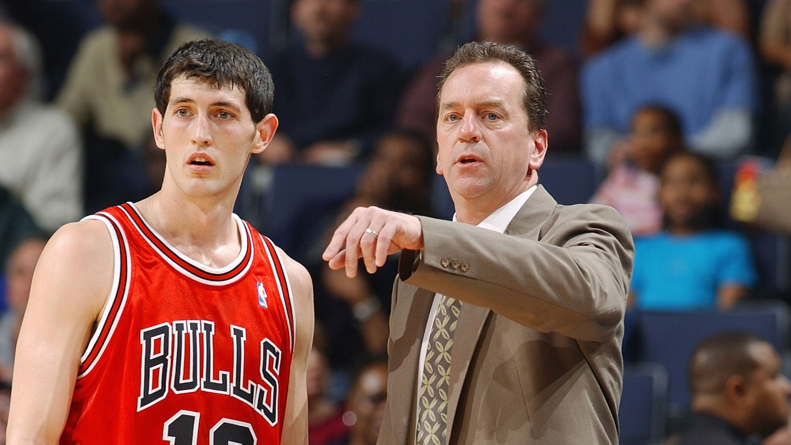 Assistant coach Jim Boylan of the Chicago Bulls talks to Kirk Hinrich #12 during the game against the Memphis Grizzlies