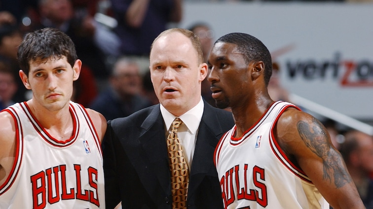 Kirk Hinrich #12, Ben Gordon #7 and Scott Skiles of the Chicago Bulls talk on the sideline during the game against the Portland TrailBlazers at the United Center on December 20, 2004 in Chicago, Illinois. The Bulls won 92-87.