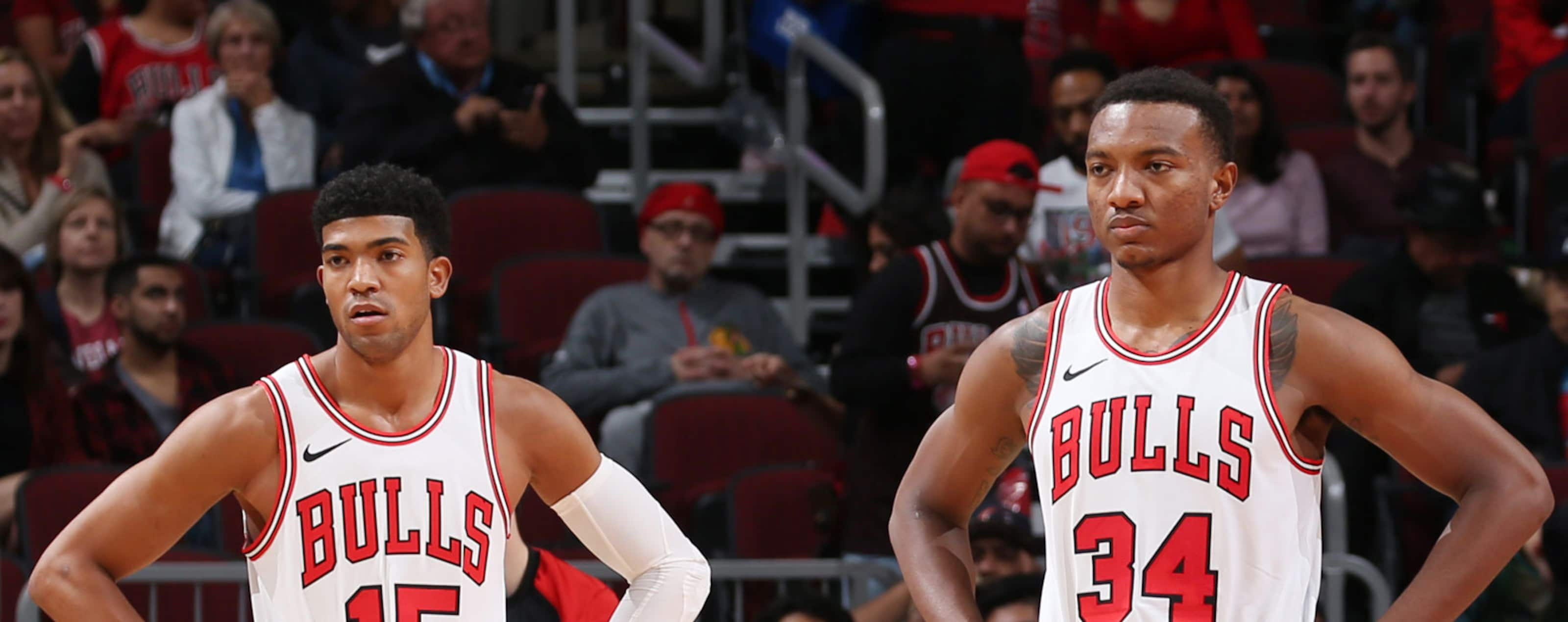Chandler Hutchison #15 and Wendell Carter Jr., #34 of the Chicago Bulls look on against the Indiana Pacers during a pre-season game on October 10, 2018 at the United Center in Chicago, Illinois.